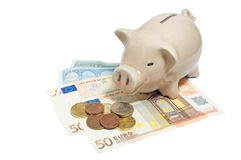 Piggy bank. Pink piggy bank and euro currency isolated on white Stock Photos