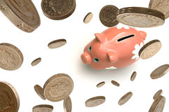 Piggy Bank. Pound coins falling onto a piggy bank Stock Images
