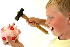 Piggy Bank. Young boy with hammer holding a piggy bank royalty free stock images