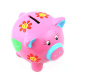 Piggy Bank. Isolated pink piggy bank shot over white background Royalty Free Stock Photography