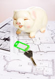 Piggy bank. Construction plan with piggy bank as symbol for building a house Stock Photo