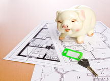 Piggy bank. Construction plan with piggy bank as symbol for building a house Stock Image