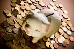 Piggy bank. On pile of coins Stock Photos