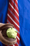 Piggy Bank. Concept image of a hot investment featuring a closeup view of a piggy bank being held by a pair of oven mitts Stock Images