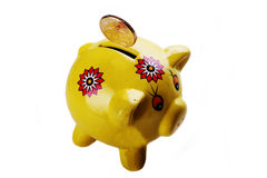 Piggy Bank. Yellow Piggy Bank against white background Stock Photo