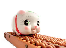 Piggy bank and abacus Stock Image