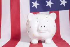 Piggy bank against  American national flag Royalty Free Stock Image