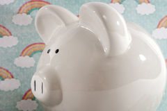 Piggy Bank against Rainbow Background Stock Images