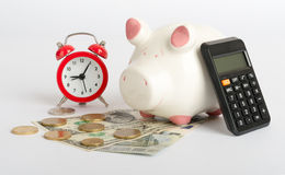 Piggy bank with alarm clock Royalty Free Stock Image