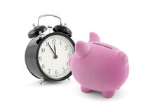 Piggy bank with alarm clock Royalty Free Stock Photo