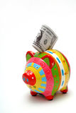 Piggy bank with American dollars Stock Photography