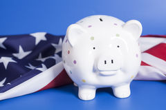 Piggy Bank with American Flag. On blue background Stock Photo