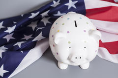 Piggy Bank with American Flag. On gray background Stock Images