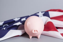 Piggy Bank with American Flag. On gray background Stock Image