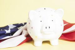 Piggy Bank with American Flag. On yellow background Stock Image