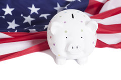Piggy bank with American national flag. On white background Stock Photo