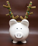 Piggy bank with antlers Stock Photography