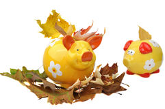 Piggy Bank in Autumn Leaves Royalty Free Stock Photos