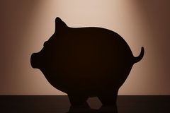 Piggy Bank with backlight over Wall. 3d Rendering Royalty Free Stock Photo