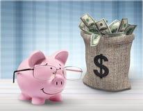 Piggy bank and bag money on table. Savings calculator pig piggy bank finance glasses Royalty Free Stock Image