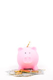 Piggy bank and banknote and gold coin Stock Photos