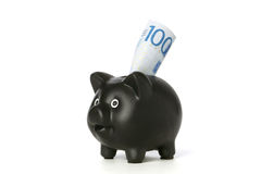 Piggy bank with 100 banknote Royalty Free Stock Images