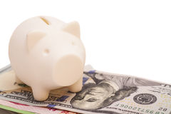 Piggy bank on banknote Stock Photo