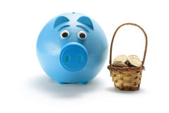 Piggy Bank and Basket of Coins Stock Photography