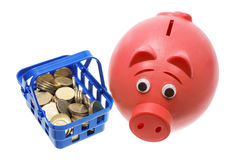 Piggy Bank with Basket and Coins Stock Photos