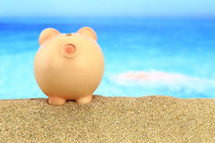 Piggy bank on the beach Royalty Free Stock Photography