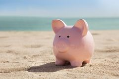 Piggy bank on beach Stock Photography