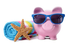 Piggy Bank on beach vacation, savings, travel money, retirement planning concept Royalty Free Stock Photo