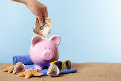 Piggy Bank beach vacation, travel money, holiday savings concept, copy space Royalty Free Stock Photography