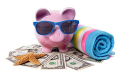 Piggy Bank beach vacation, travel money, holiday savings concept Royalty Free Stock Photos