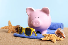 Piggy Bank beach vacation, travel money, holiday savings concept Royalty Free Stock Photography