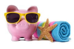 Piggy Bank beach vacation, travel money, holiday savings concept Royalty Free Stock Image
