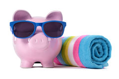 Piggy Bank on beach vacation, travel money vacation savings concept Stock Photo