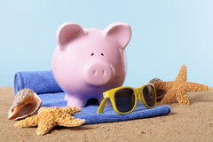 Piggy Bank beach vacation, vacation savings, holiday money travel concept Royalty Free Stock Image