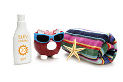 Piggy Bank on beach vacation Stock Images