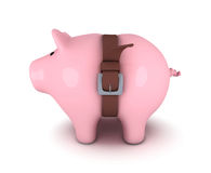 Piggy bank with belt tighten Royalty Free Stock Photography