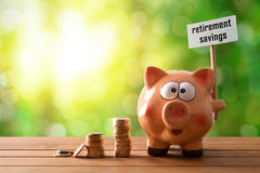 Piggy bank with billboard retirement savings on table nature bac Royalty Free Stock Images