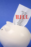 Piggy Bank and bills Stock Photography