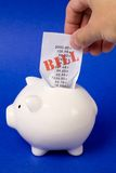 Piggy Bank and bills Royalty Free Stock Images