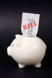 Piggy Bank and bills Stock Images