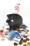 Piggy bank with bills and coins Royalty Free Stock Image