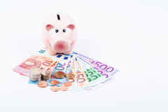Piggy bank. With bills and coins in euro Stock Photo