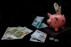 Piggy bank on a black background. Rubles stock photo