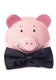 Piggy bank with black bow tie Stock Photos