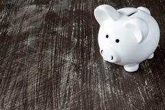 Piggy bank on the black surface Stock Photos