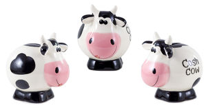 Piggy bank with black and white cow spots Stock Photo